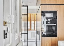 Hexagonal-3D-tiles-on-the-floor-along-with-oak-wooden-cabinets-in-the-kitchen-217x155