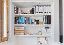 Home-office-in-the-corner-in-white-with-smart-shelves-217x155
