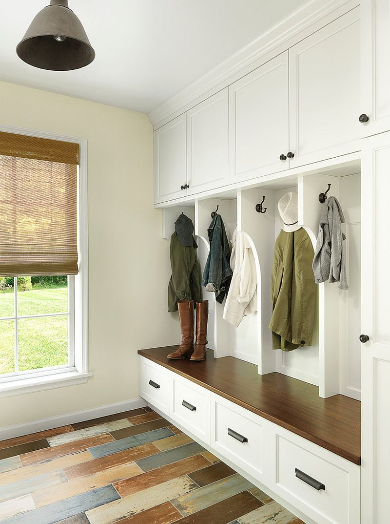 Hooks, closed cabinets and a bench are a staple of the modern mudroom