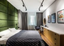Keeping-the-bedroom-as-neutral-as-possible-allows-the-green-tufted-accent-wall-to-shine-through-217x155