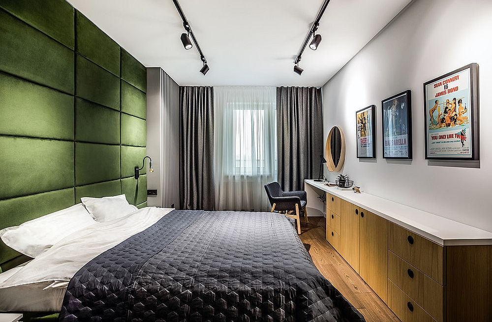Keeping-the-bedroom-as-neutral-as-possible-allows-the-green-tufted-accent-wall-to-shine-through