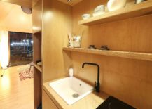 Kitchen-of-the-tiny-house-with-wooden-shelves-and-smart-cabinets-217x155