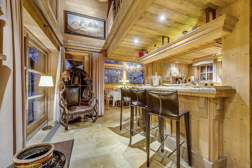 Lavish leather setaing pampers you inside the chalet kitchen as well