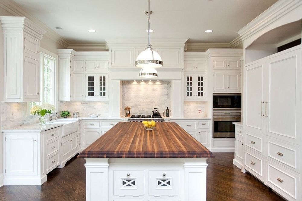 Let the countertops bring wooden element to the kitchen in white