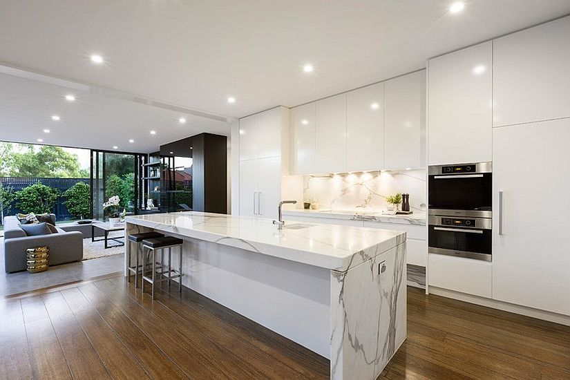 Let the floor bring a bit of woodsy warmth to the all-white kitchen