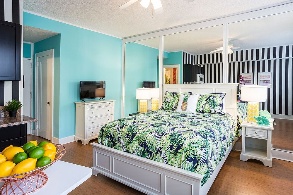 Light blue and bedding bring brightness to the bedroom