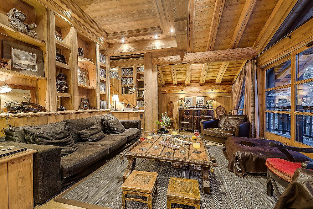 Living area of the chalet with multiple seating options and a luxurious ambiance