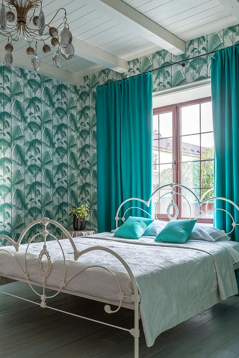 Lovely use of green and teal in the vivacious tropical style bedroom