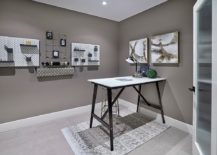 Minimal-and-functional-home-office-in-gray-with-smart-wall-storage-options-217x155