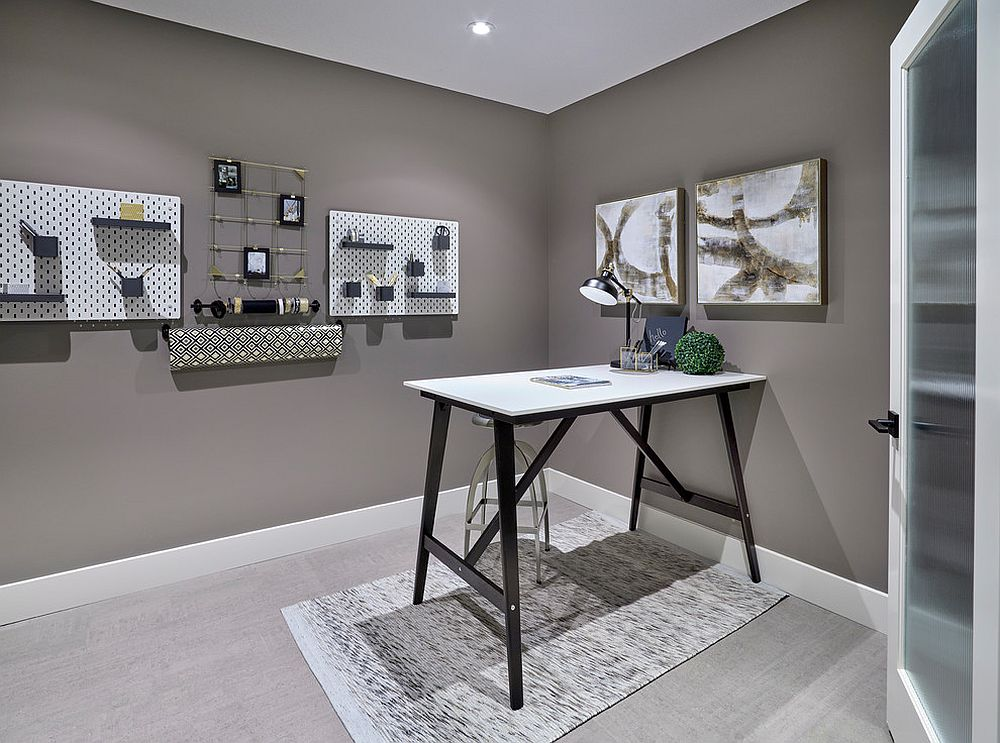 Minimal and functional home office in gray with smart wall storage options