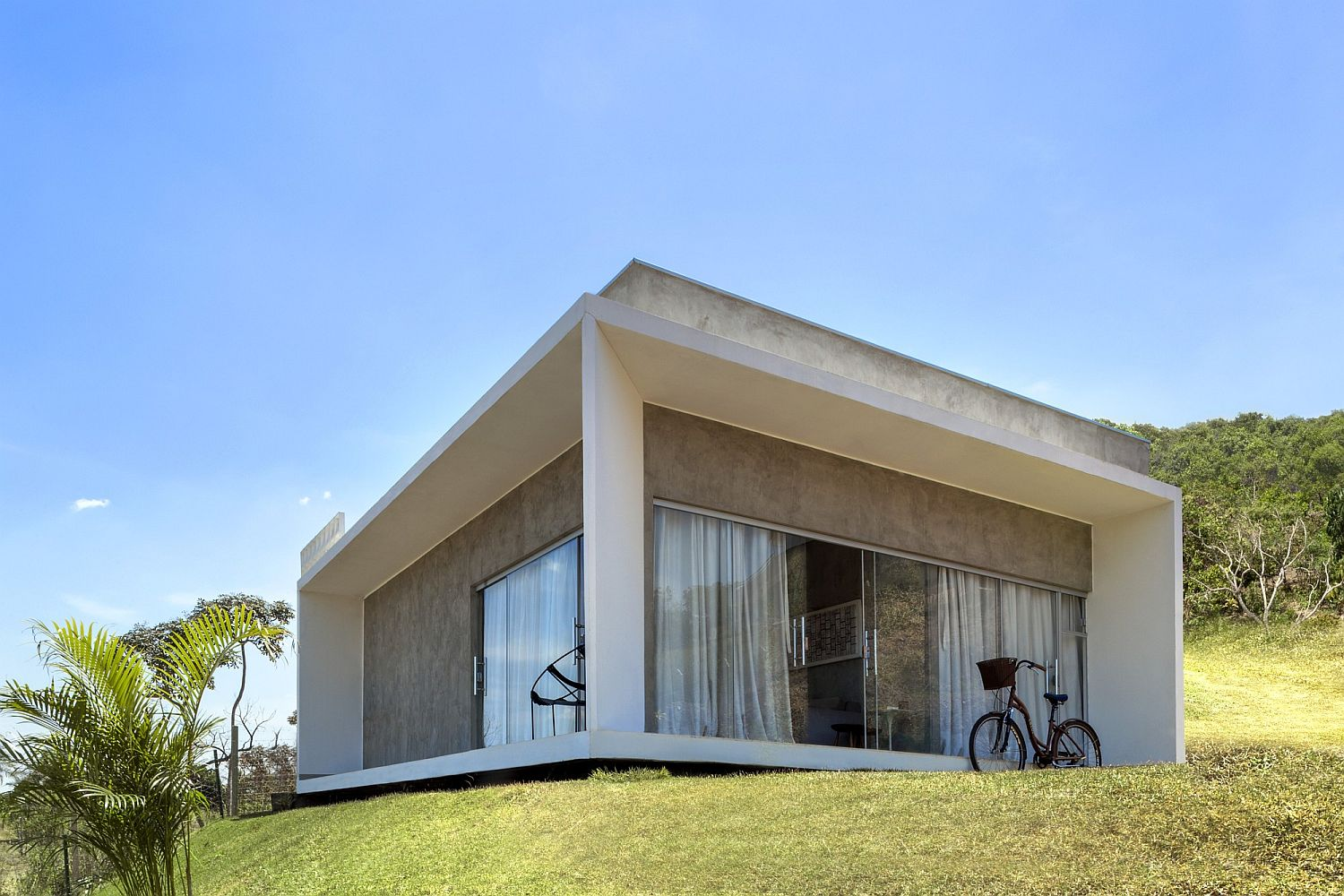 Minimal modern home with a lovely view of natural reserve in Brazil