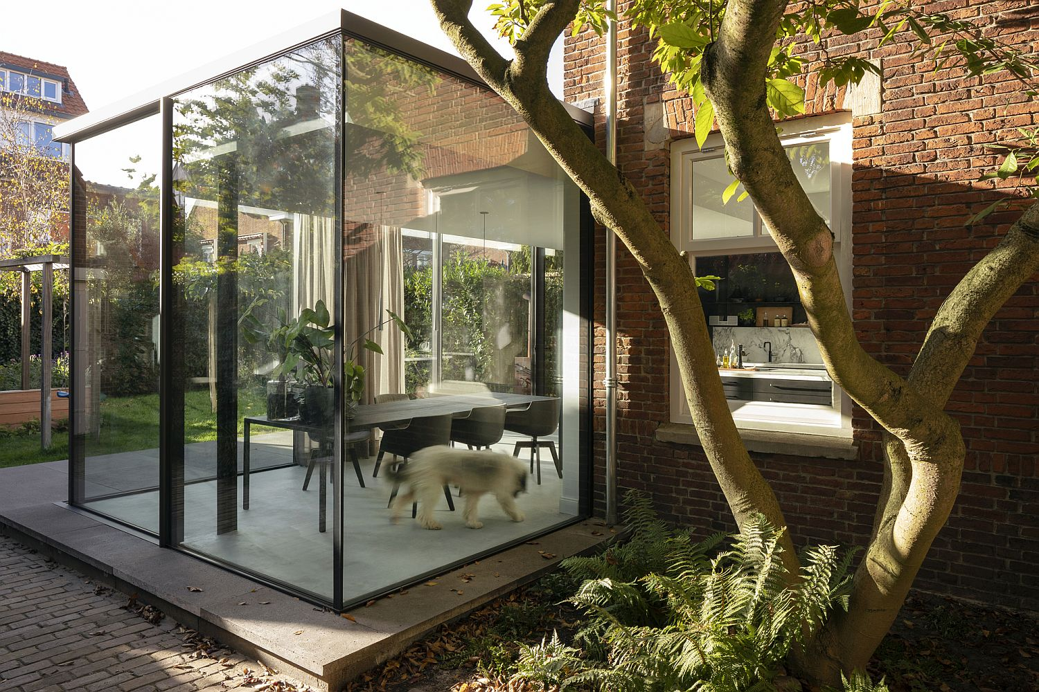 Glass Extension Breathes Life into 1920's Brick House in the Hague