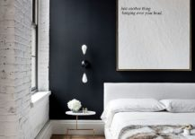 Modern-industrial-bedroom-with-whitewashed-brick-walls-and-black-accent-wall-217x155