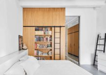 Oak-cabinets-and-multi-tasking-shelves-are-spread-out-in-the-apartment-217x155