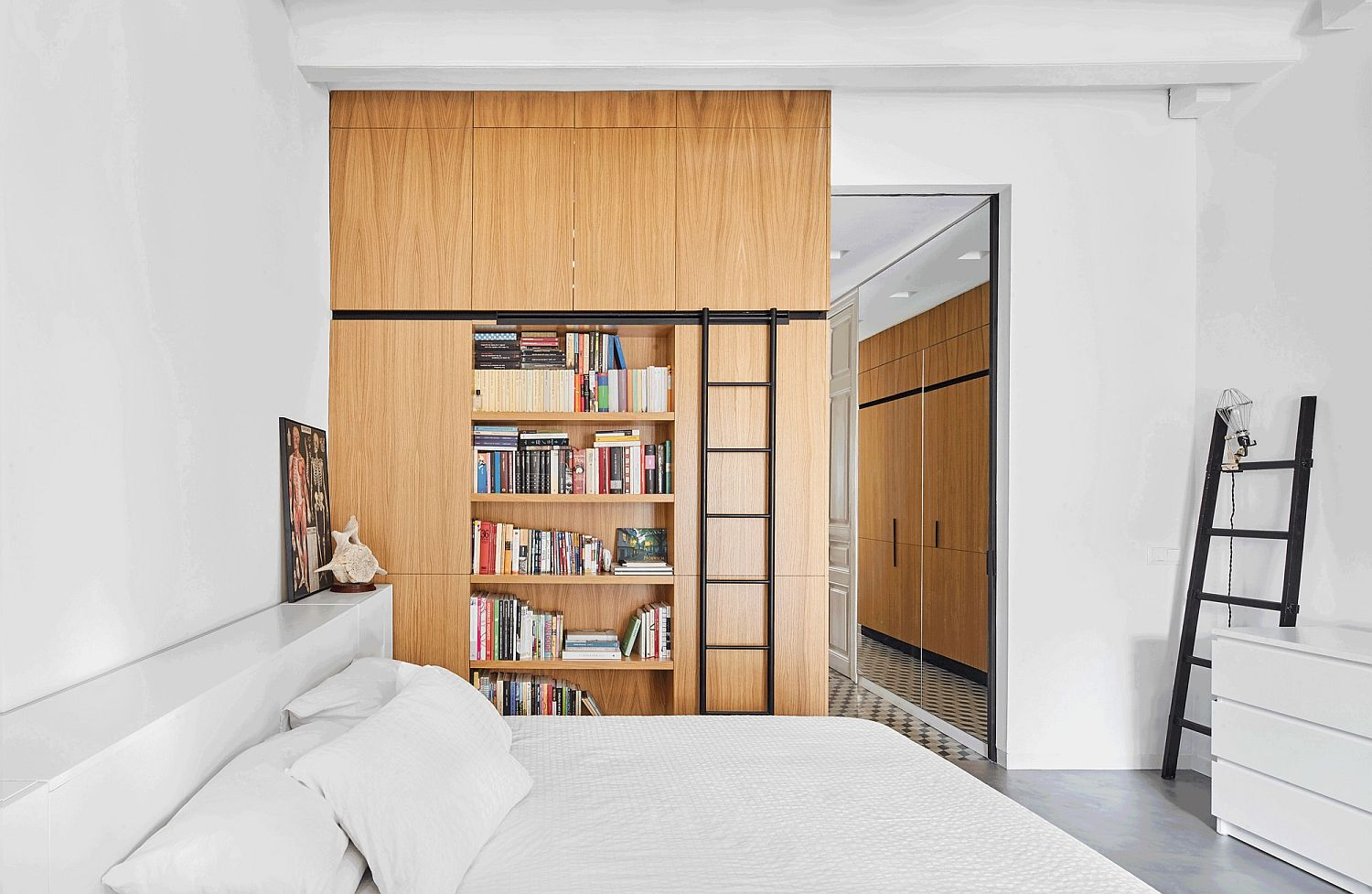 Oak cabinets and multi-tasking shelves are spread out in the apartment