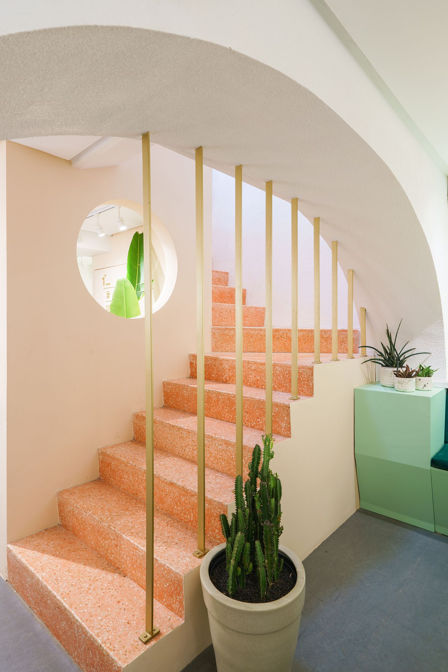 Pastel green and orange add brightness to the cafe interior