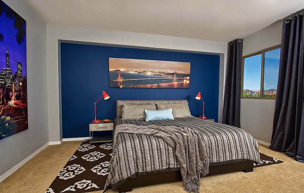 Photographs of city skylines add brightness to this bedroom