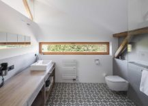 Polished-and-elegant-bathroom-in-white-and-wood-217x155