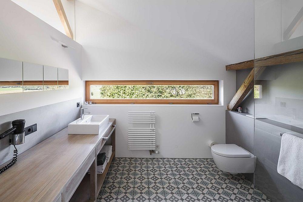 Polished and elegant bathroom in white and wood