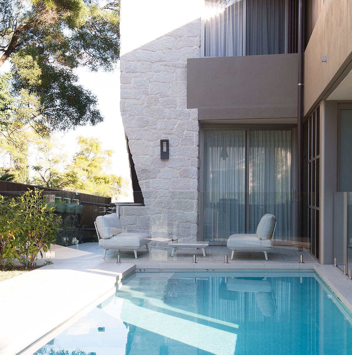 Pool are aaround the house along with sheltered sitting spaces