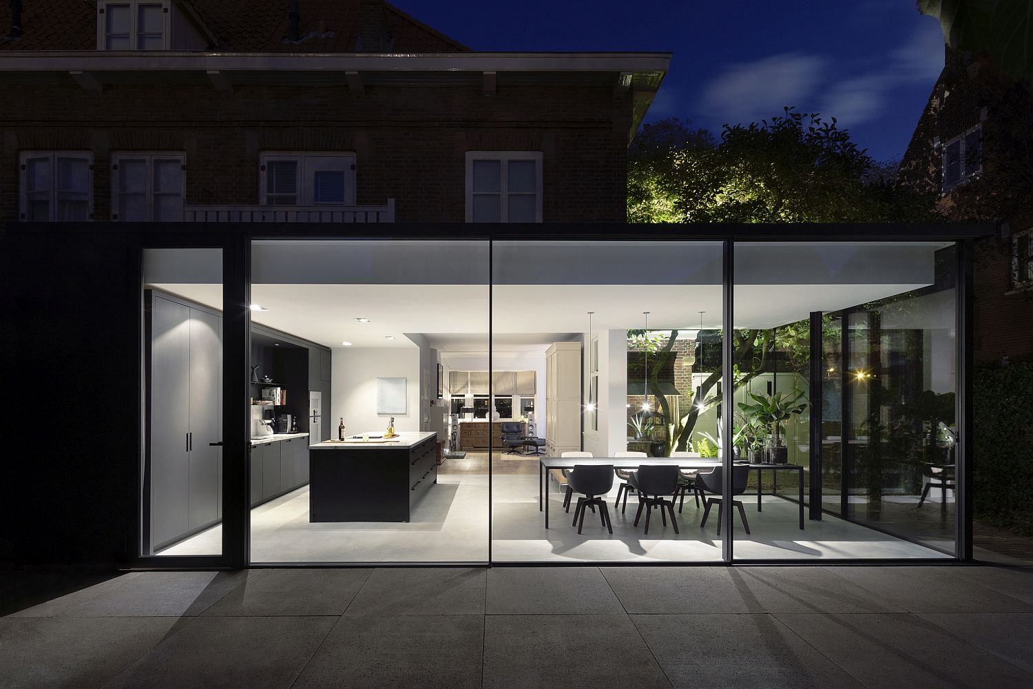 Sliding glass walls and doors for the modern extension of Dutch house