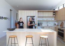 Smart-and-functional-modern-kitchen-in-wood-and-white-with-open-shelving-217x155