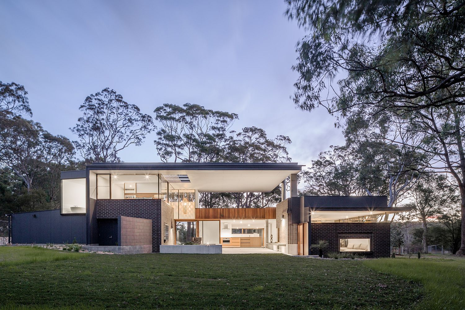 Smart and modern Aussie home overlooks the bushland and the distant coastline