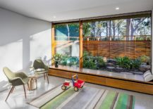 Smart-use-of-glass-walls-and-wooden-storage-and-seat-217x155