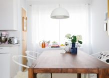 Smart-white-pendant-melts-into-the-white-backdrop-of-the-dining-room-effortlessly-217x155