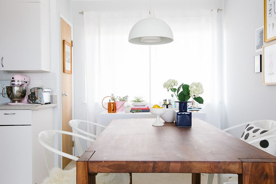 Smart white pendant melts into the white backdrop of the dining room effortlessly