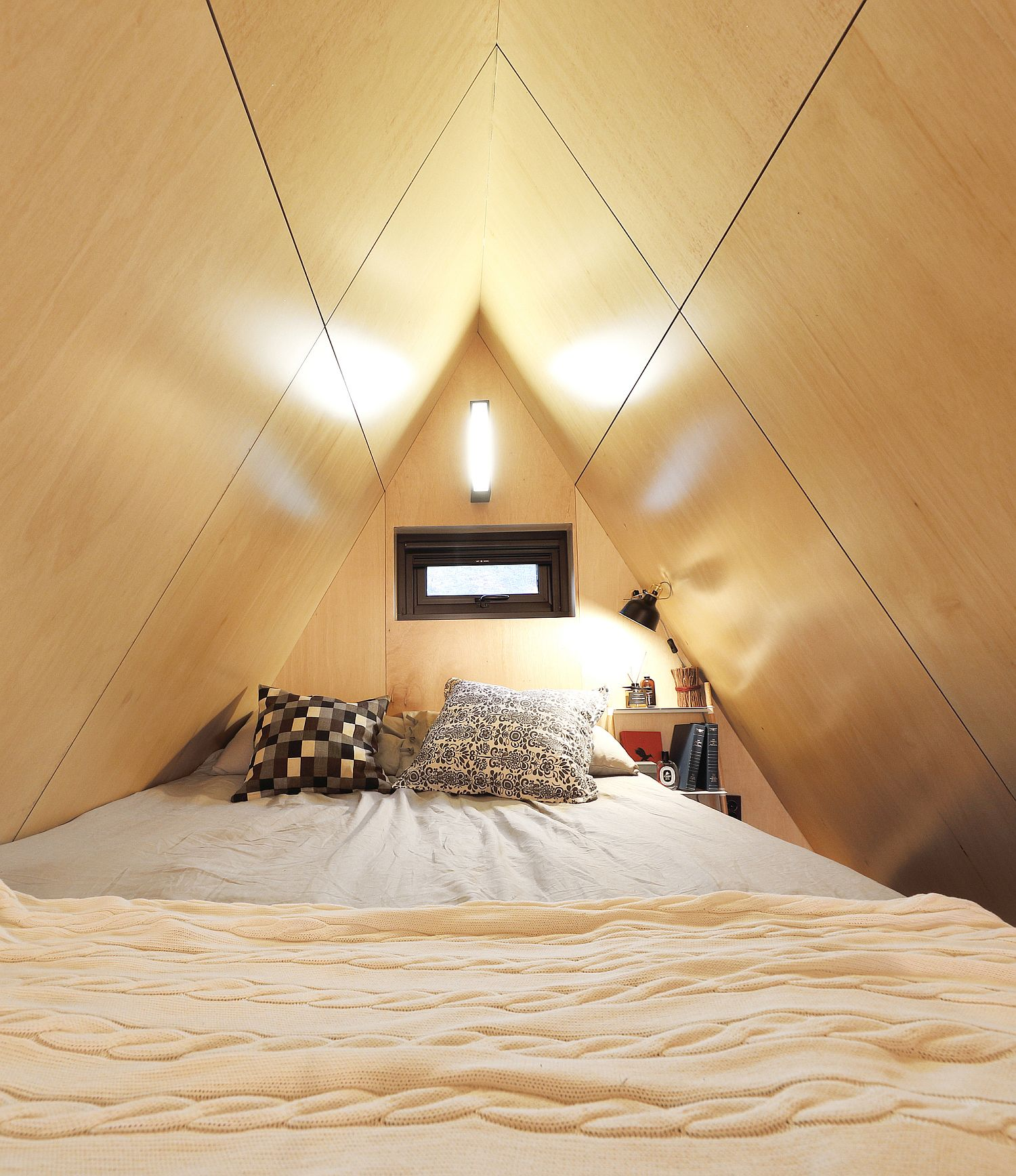 Space-savvy and woodsy bedroom of the tiny house with natural ventilation