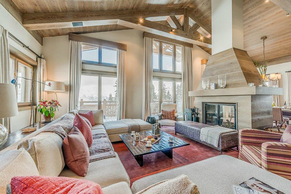 Spacious lounge of the chalet with spectacular alpine view