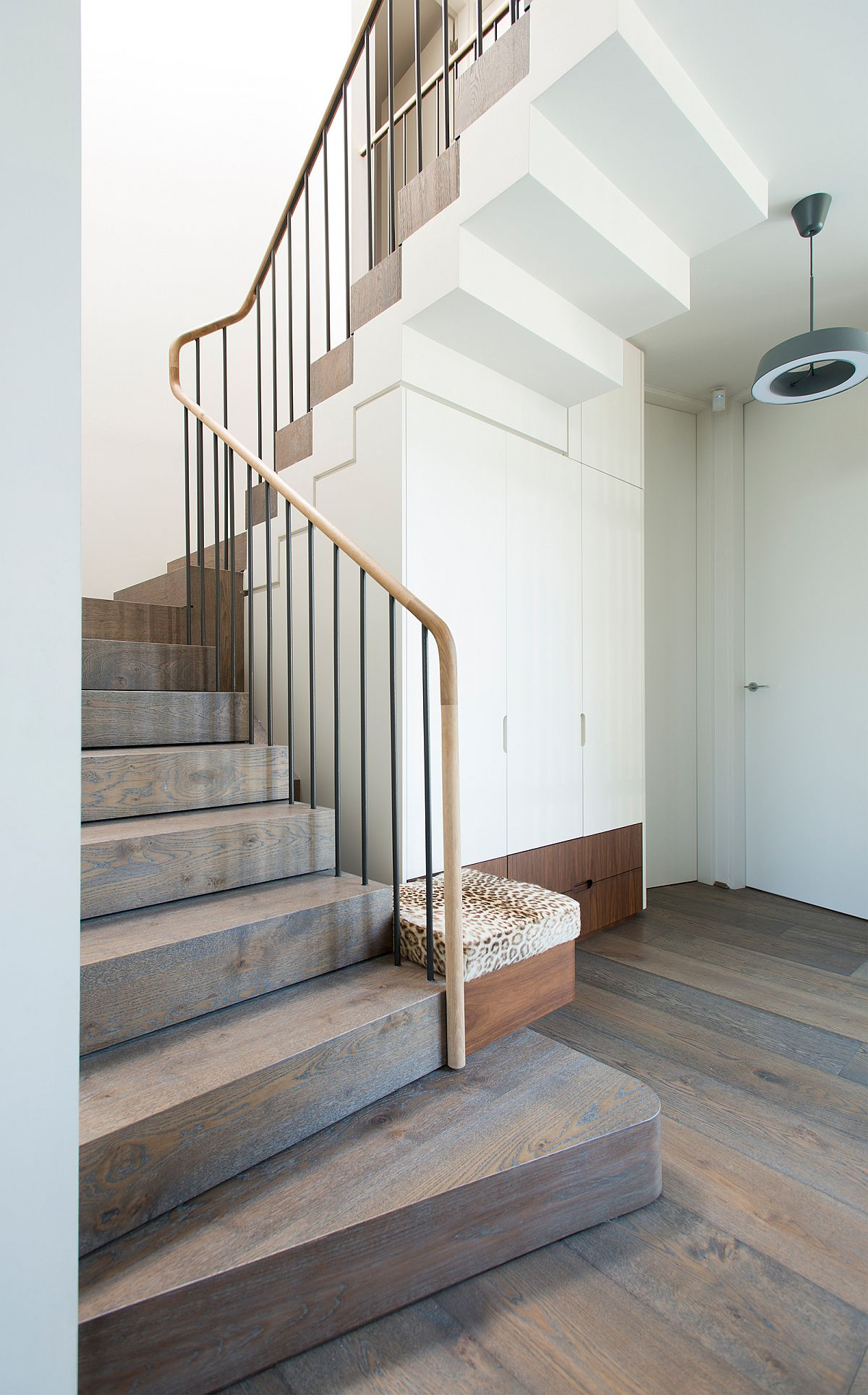 Stairway connecting the two levels of the modern suburban home