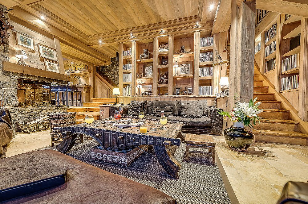 Stone and wood shape the stunningly beautiful interior of the chalet