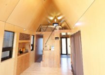 Tiny-House-with-loft-level-bedroom-in-wood-217x155