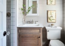 Tiny-bathroom-in-white-with-small-wooden-vanity-217x155