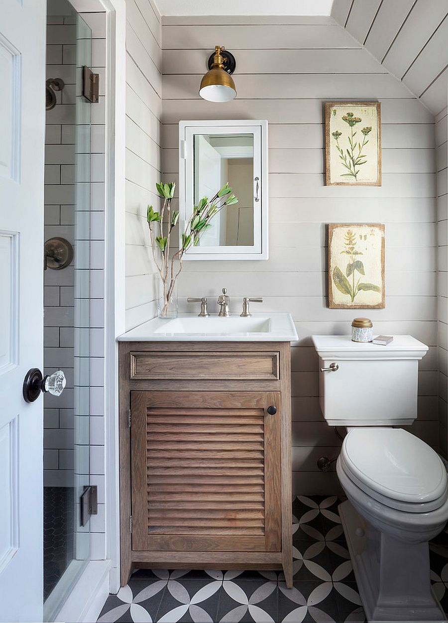 Tiny-bathroom-in-white-with-small-wooden-vanity