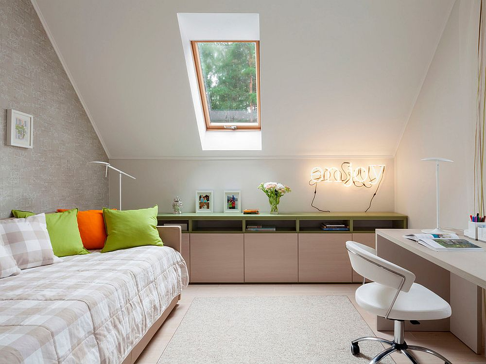 Tiny bedroom of Moscow apartment with brightly illuminated sign in the corner