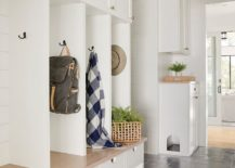 Utlizing-vertical-space-to-the-hilt-in-the-modest-mudroom-217x155