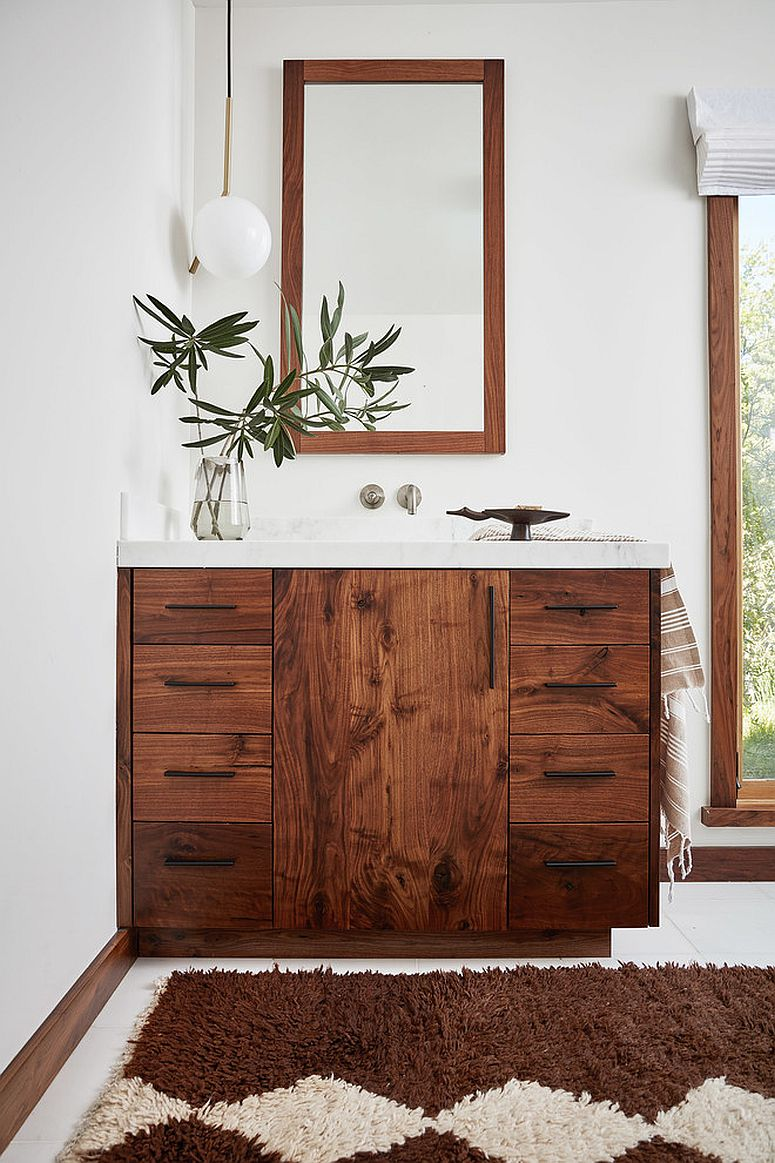 Vanity-and-mirror-frame-adds-woodsy-element-to-the-bathroom-in-white