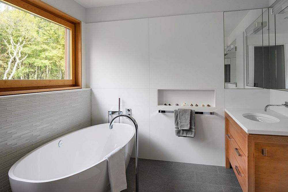 Vanity-and-window-frame-in-wood-for-the-smart-white-bathroom