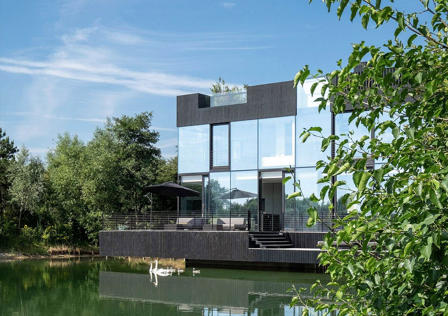Villa on a Lake clad in glass