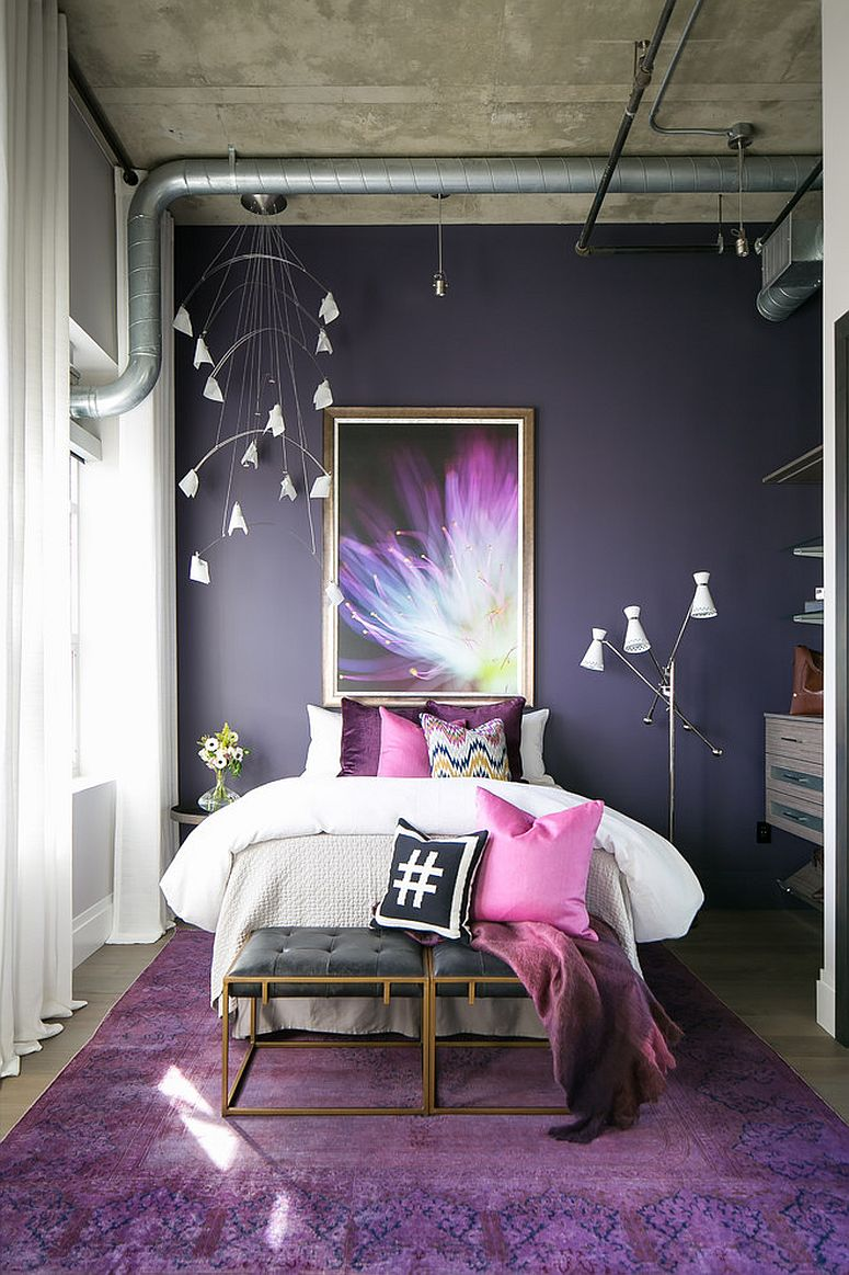 Wall-art-adds-to-the-color-scheme-of-the-industrial-bedroom