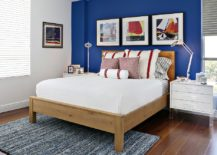 Wall-art-coupled-with-accent-wall-creates-a-stylish-focal-point-in-the-bedroom-217x155