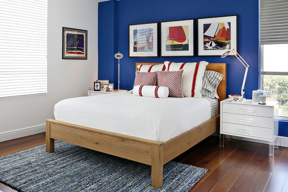 Wall art coupled with accent wall creates a stylish focal point in the bedroom