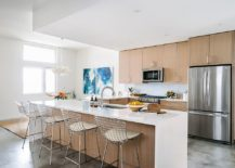 White-and-wood-beach-style-kitchen-with-blue-wall-art-in-the-corner-217x155