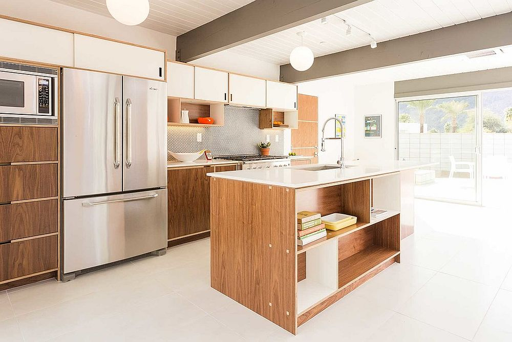 White and wood cabinets along with island perfectly fit into the midcentury style of the kitchen