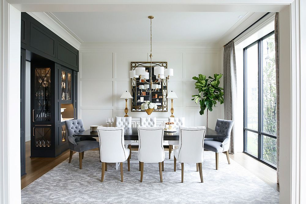 White chandelier coupled with table lamps in the backdrop paint a curated modern picture