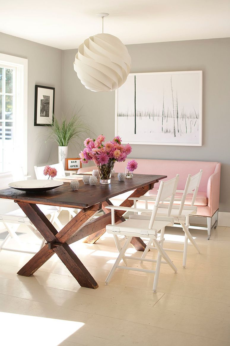 White pendant light adds pattern without altering the color scheme of the dining space