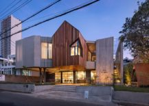 Wood-and-concrete-along-with-cantilevered-gable-structure-give-the-cafe-home-a-unique-look-217x155